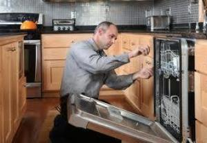 Technician working on Dishwasher in Kitchen